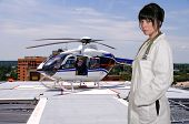 stock photo of medevac  - Woman doctor and a mobile flying ambulance better known as a life flight - JPG