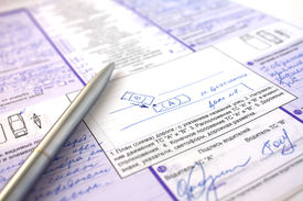 stock photo of driving school  - Insurance payment at damage of the car filling of documents - JPG