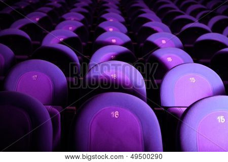 Empty Movie Theater With Purple Seats