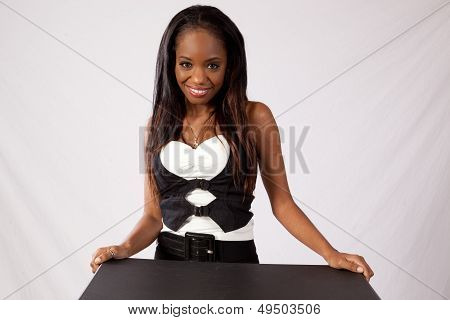 Pretty black woman smiling at the camera
