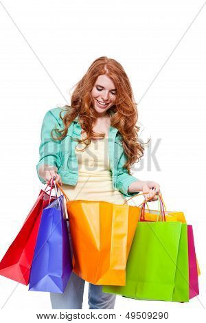 Smiling Young Redhead Girl With Colorful Shoppingbags