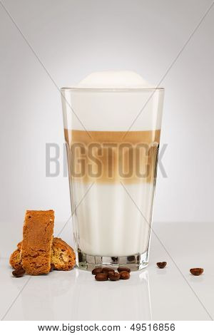 Latte Macchiato With Coffee Beans And Cookies