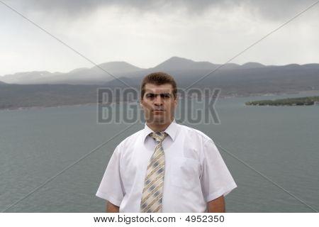 Man Poses On Sevan Lakeside