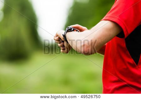 Runner Checking Gps