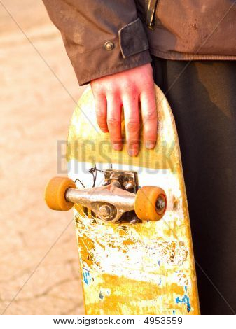 Gunge Image Of A Skater Holding His Skateboard
