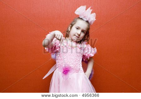 Portret Of Little Girl Dressed In Pink With Wings