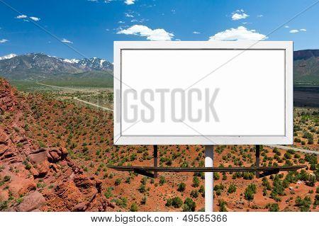 Billboard Sign On Empty Highway In Desert