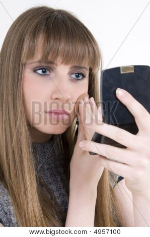 Female Model With Make Up And Mirror