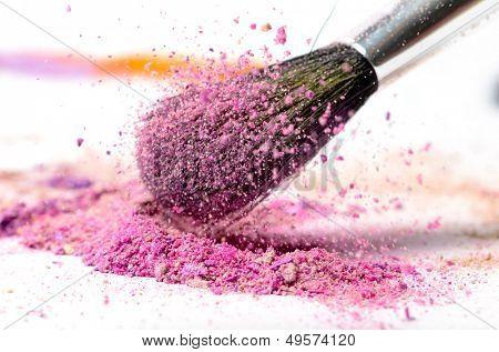 professional make-up brush on colorful crushed eyeshadow