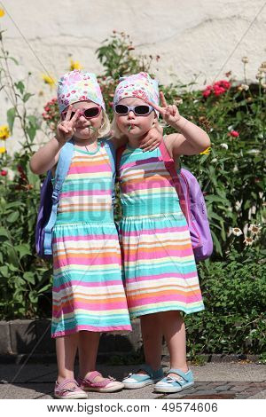Cute Little Twin Girls Making V-signs