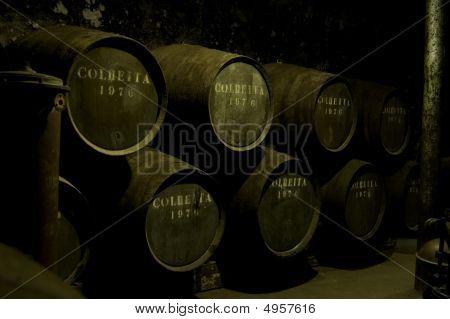 Wine Barrels In A Dark Warehouse