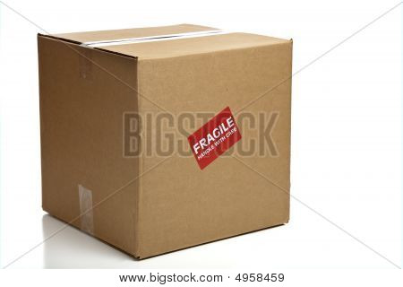 Blank Closed Cardboard Box With A Fragile Sticker