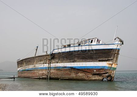 Khor Fakkan UAE old wooden dhow washed up on shore
