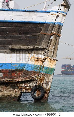 Khor Fakkan UAE old wooden dhow washed up on shore in front of Khor Fakkport
