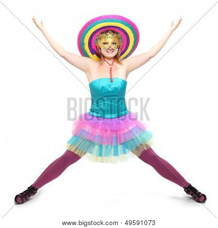 Pretty showgirl with golden mask and colorful sombrero dressed in luxury retro costume.