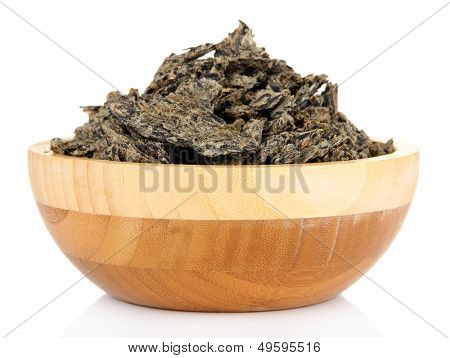 Oil cake in wooden bowl, isolated on white
