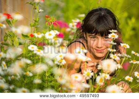 Portrait teengirl among wildflowers