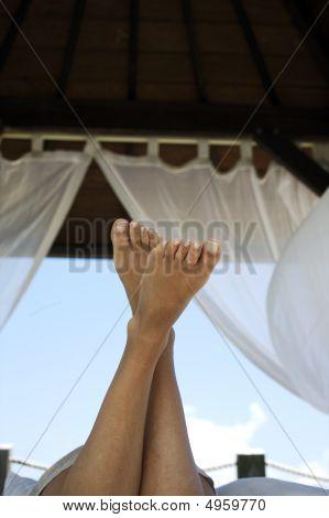 Woman Lying In A Gazebo