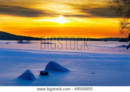 Golden Sunset On A Frozen Lake