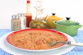 stock photo of crawfish  - Spicy crawfish etouffee Cajun Dinner in colorful setting against white background - JPG