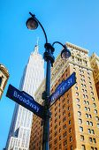 stock photo of empire state building  - Broadway sign and Empire State building in New York City - JPG
