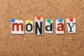stock photo of weekdays  - The word Monday in cut out magazine letters pinned to a cork notice board - JPG