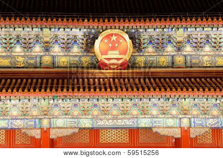 BEIJING, CHINA - APR 1: Tiananmen exterior with national emblem at night on April 1, 2013 in Beijing, China. It is a famous monument in Beijing and serves as a national symbol.