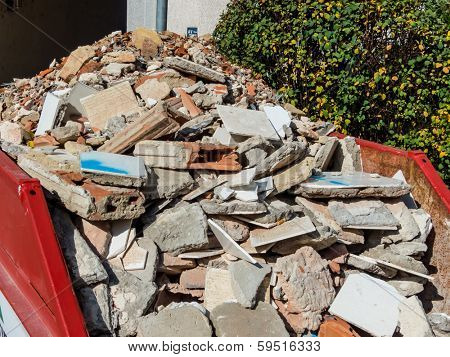 rubble from the demolition of a residential building in a container
