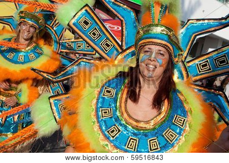 Sesimbra, Portugal - February 12, 2013: Member of the Ala section of the Samba School parade wearing the thematic costume in the Brazilian Carnival on Feb/12/2013 in Sesimbra, Portugal