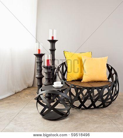 Metal Sofa With Yellow Pillow
