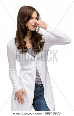 Portrait of woman covering her nose, isolated on white. Concept of stink and disgust