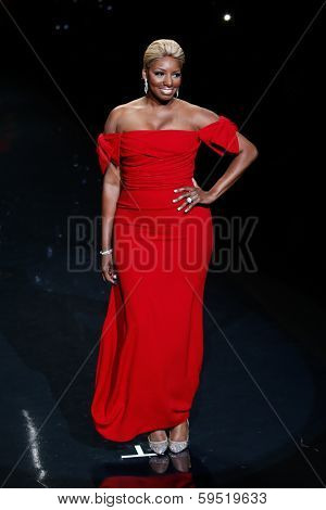 NEW YORK-FEB 6: NeNe Leakes wears Dolce & Gabana on the runway at The Heart Truth Red Dress Collection show during Mercedes-Benz Fashion Week at Lincoln Center on February 6, 2014 in New York City.
