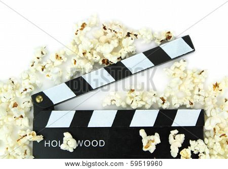Movie clapper with popcorn