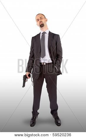 Businessman In Handcuffs With Pistol In Hand