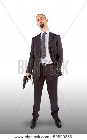 Businessman In Handcuffs With Pistol In Hand
