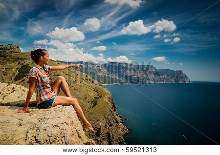 Young woman  on a rock