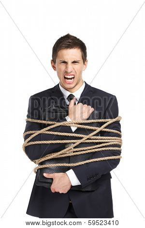 Portrait of businessman screaming and handing briefcase who tied with the rope, isolated on white. Concept of slavery and violence