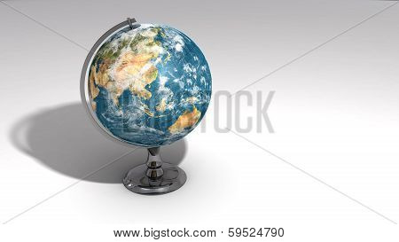 A Realistic Globe On A Chrome Pedestal Over White B