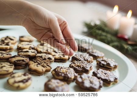 Woman is making christmas cakes