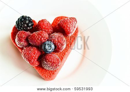 Heart shaped cake with berries