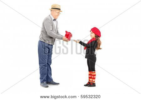 Full length portrait of grandfather giving present to his little niece isolated on white background