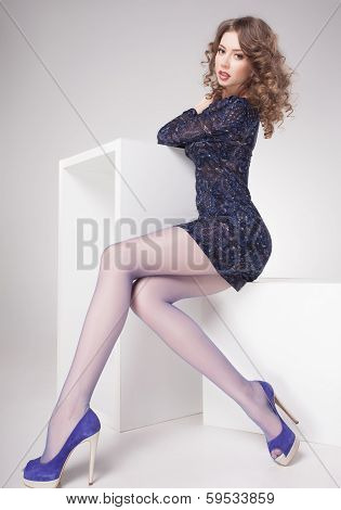 Beautiful Woman With Long Sexy Legs Dressed Elegant Posing In The Studio - Full Body