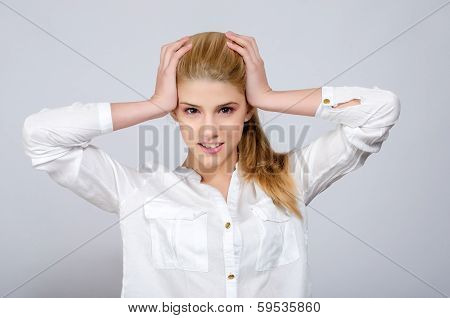 Young girl with hands on her head being desperate.