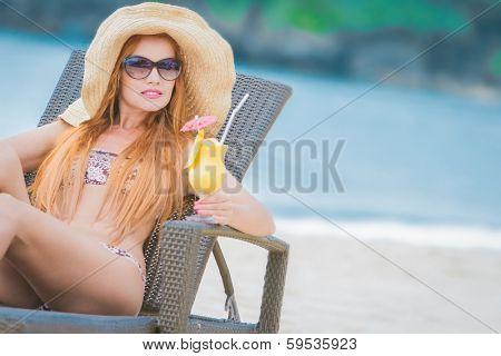young beautiful woman relaxing on tropical beach
