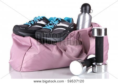 Sports bag with sports equipment isolated on white