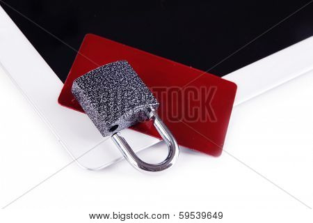 Credit card with lock and tablet isolated on white