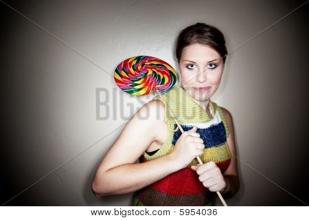 Cute Girl In Spotlight With Lollipop