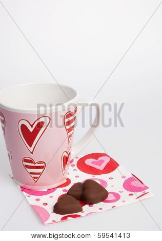Heart Decorated Cup And Chocolate