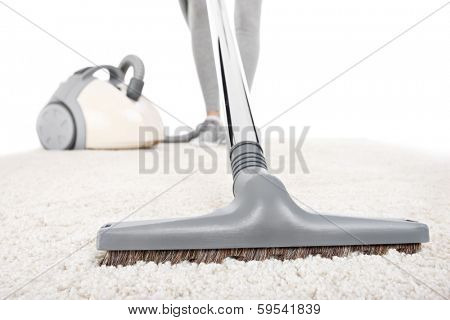 A picture of a carpet being vacuumed over white background