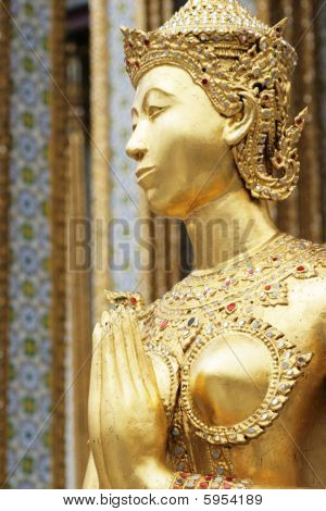 figure at Wat Prakaew, Thailand's ancient royal temple and palace.